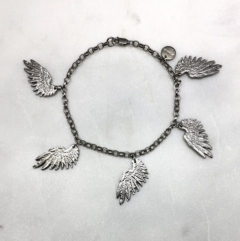 Five Tiny Silver Wings Bracelet