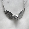 Silver Winged Skull Necklace With Garnet Eyes