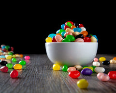 Making jelly bean rainbows is an easy science birthday party experiment for children of all ages.