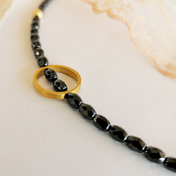 Dainty Boho Hematite Bracelet with a gold circle
