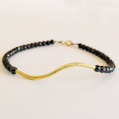 Dainty Boho Hematite Bracelet with a twisted bar