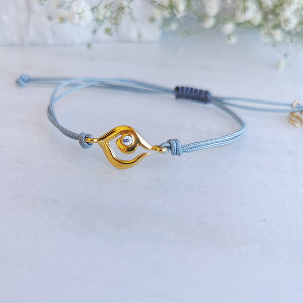 Protection Bracelet with a Gold Evil Eye pendant with a zircon
