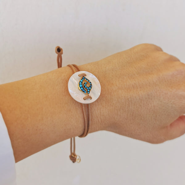 Evil Eye Bracelet handmade with mother of pearl gemstone and Turquoise zircons !