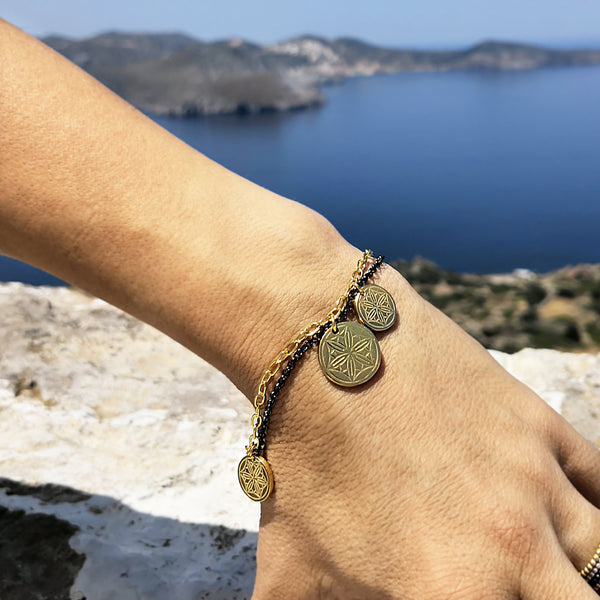 Gold Coin Bracelet with greek coins and hematite gemstone in a shell