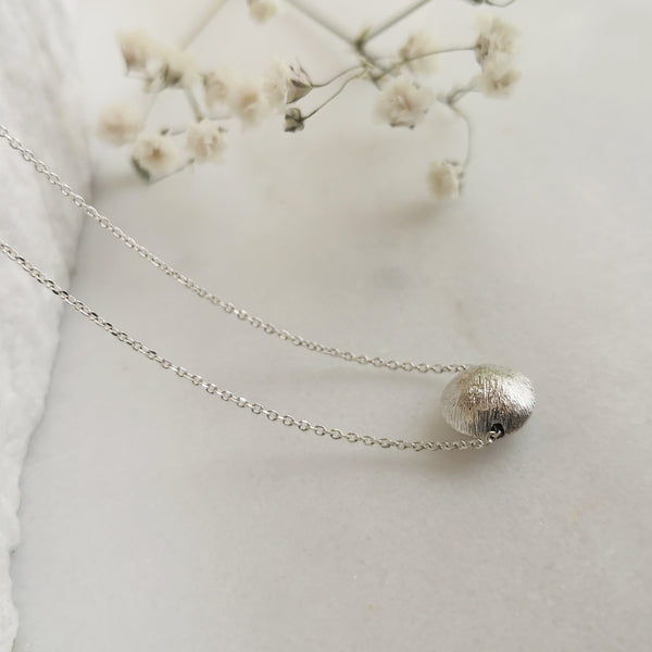 Minimalist Necklace with a shiny silver sphere pendant