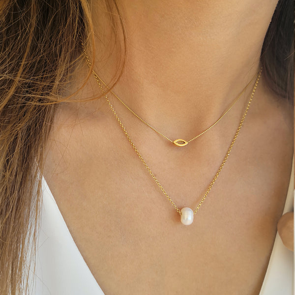 Layered Necklaces set with a tiny eye pendant and a genuine pearl.