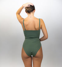 Load image into Gallery viewer, This shows the model wearing the bodysuit and nothing else, her back is facing us.