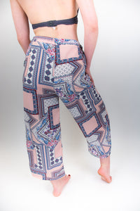 The model in this photo is wearing very flowy pants and her back is to us. This shot clearly shows the large square pattern that covers these pants.