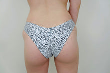 Load image into Gallery viewer, This photo shows an up-close shot of the cheeky bottoms, except they are in the color white with very small dots on them everywhere.