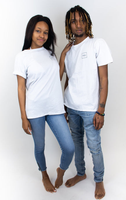 Photo shows a couple both wearing white cotton T-shirts, both shirts have a small