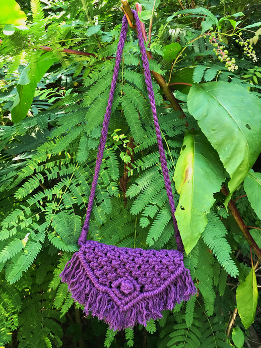 Photo shows a grape shoulder bag that is knotted in purple cotton