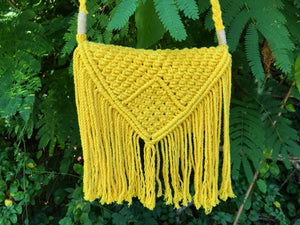 Photo shows a sunshine yellow bag and the knotting details that the bag has