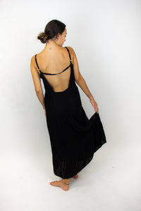 The dress being shown in this photo is long (to the ankles) and black, the back of it is taken out and there is a strap going across the mid-back and then connecting to the spaghetti straps.