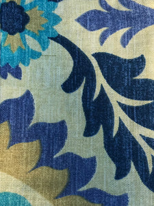 Photo shows a fabric that is cream with a blue and beige floral print on it. This fabric can be chosen when buying the zip pouch