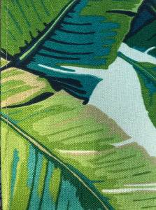 Photo shows a banana leaf fabric that has a white background, this fabric can be chosen when buying a zip up pouch