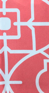 Photo shows a coral and white pattern that is on one of the fabric options for the zip up pouch