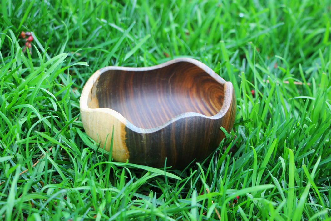 Photo shows three bowls laying in a field of grass. There is a small a medium and a larger size.