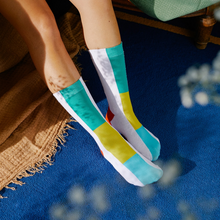 Load image into Gallery viewer, model wearing rainbow socks doiy