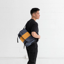Load image into Gallery viewer, SMALL CLASSIC MESSENGER BAG | LIGHTBEAM MAN MODELLING BAG