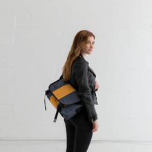 Load image into Gallery viewer, SMALL CLASSIC MESSENGER BAG | LIGHTBEAM WOMAN MODELLING BAG