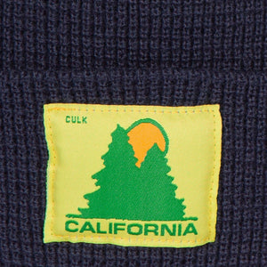 CLOSE UP OF CA LUMBER SUPPLY BEANIE LABEL