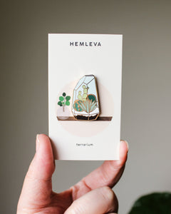 TERRARIUM PIN in box being held
