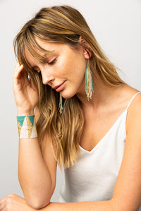 WOMAN WEARING IVORY AND TEAL OMBRE LUXE EARRING