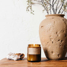 Load image into Gallery viewer, AMBER & MOSS 7.2 OZ SOY CANDLE next to a pot