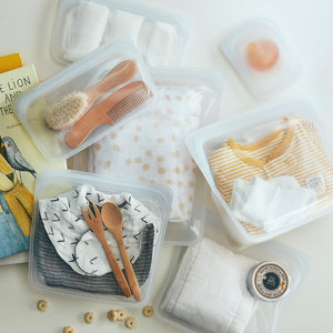 CLEAR STASHERS FILLED WITH BABY PRODUCTS