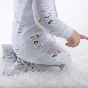 close up of baby wearing SEA THE WORLD onesie