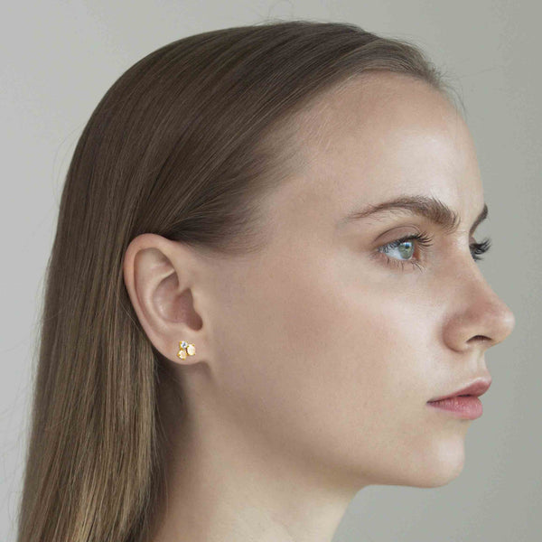 woman wearing cluster cz post earrings