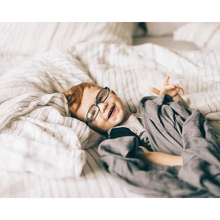 Load image into Gallery viewer, BOY WRAPPED UP IN SWADDLES ON BED