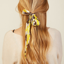 Load image into Gallery viewer, MODEL WEARING GOLDEN FLORAL HAIR SCARF