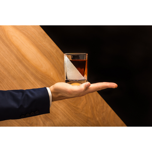MAN HOLDING WHISKEY WEDGE GLASS