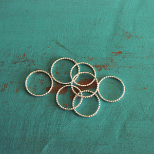 STACK OF TWISTED STACKING RINGS