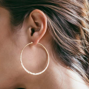 "woman wearing hammered 2"" gold hoop side profile"