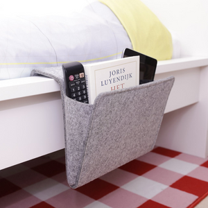 LIGHT GRAY FELT BEDSIDE CADDY BEING USED ON A BED