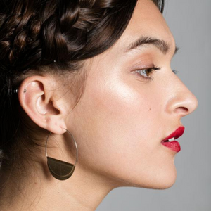 WOMAN WEARING HATHOR HOOPS