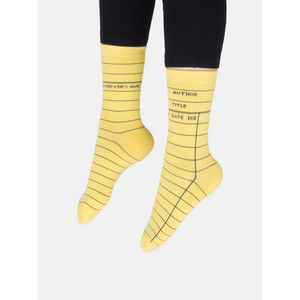 person wearing library card socks