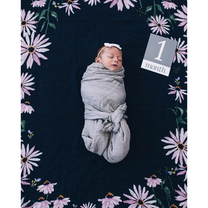 BABY IN SWADDLE ON DARK CONEFLOWER PHOTO BLANKET