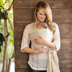 MOTHER WITH BABY IN MOBY EVOLUTION WRAP IN ALMOND