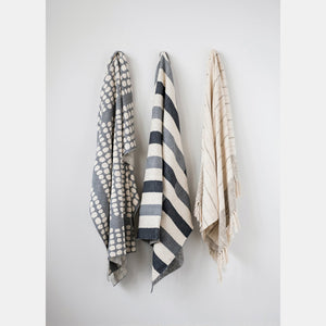 gray striped throw hanging on wall