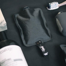 Load image into Gallery viewer, FLATPAK TOILETRY BOTTLE AMONGST OTHER TRAVEL GEAR