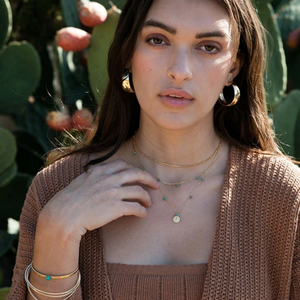 MODEL WEARING 70'S STYLE VINTAGE HOOPS