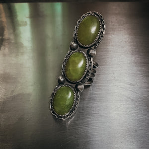 Triple serpentine ring size 7