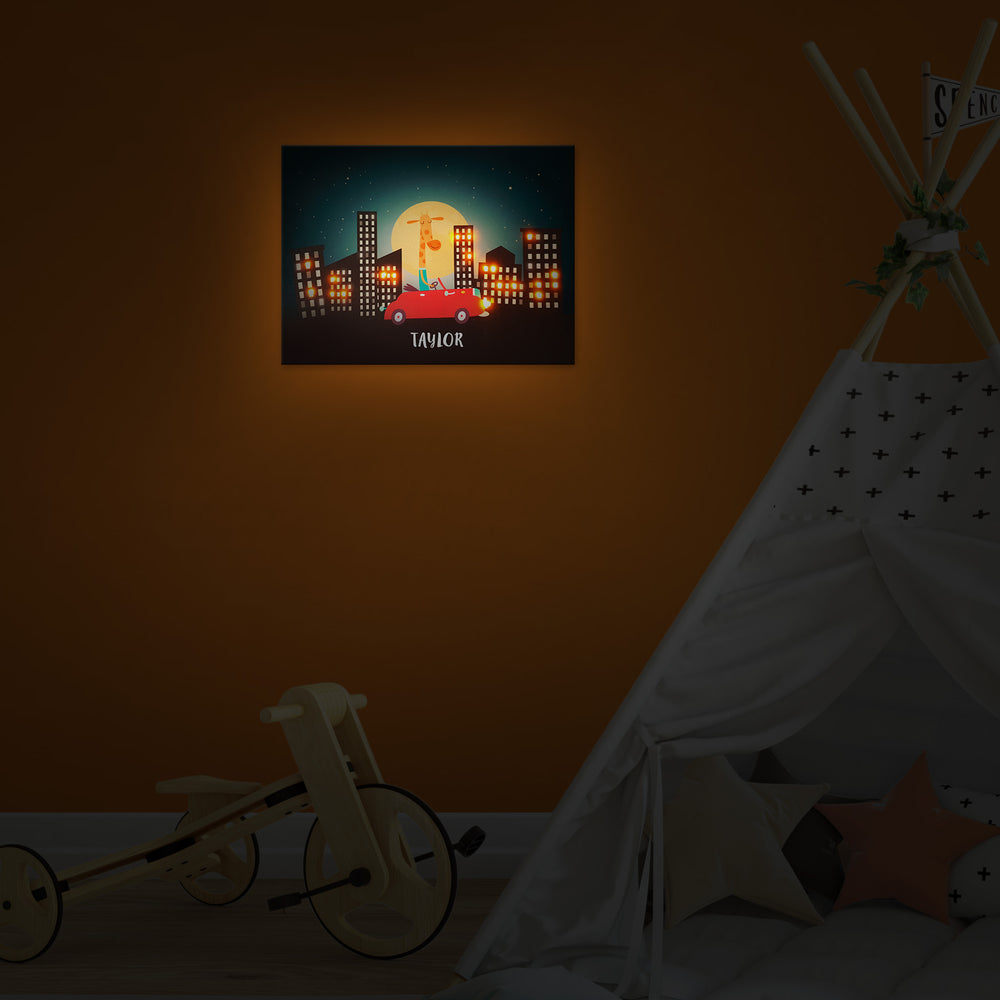 Ellybean Light Up Canvas, title Tall Wild & Free, Giraffe in Red Car, cityscape, 20 LED lights in windows, Battery Operated, Personalised with Name Below, Lights On, Hanging on Wall, Kids Room Decor, Night, Illustration Only