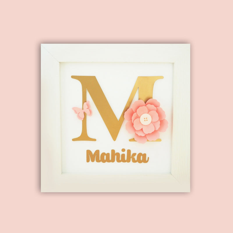 Ellybean Personalised Pop Up Frame, White wooden frame, big gold personalised letter, baby pink paper flowers and butterfly & gold name below.