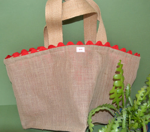 Tote bag with plant and red trim, in jute