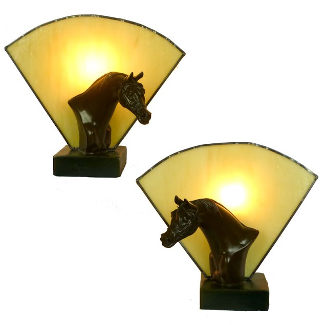 Pair of brown horses with amber tTffany fan glass.