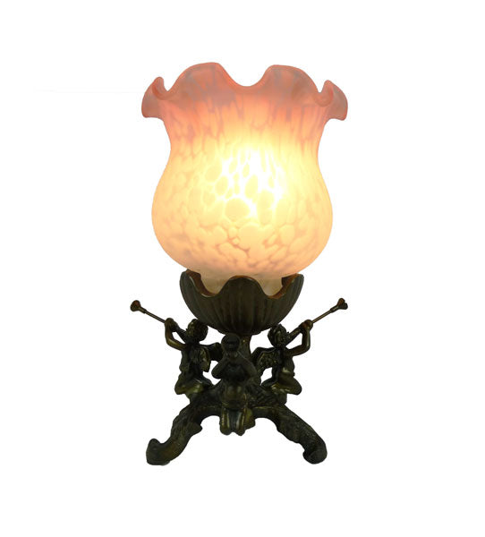 Trumpeting cherub white with pink tip pumpkin glass on a brown base.